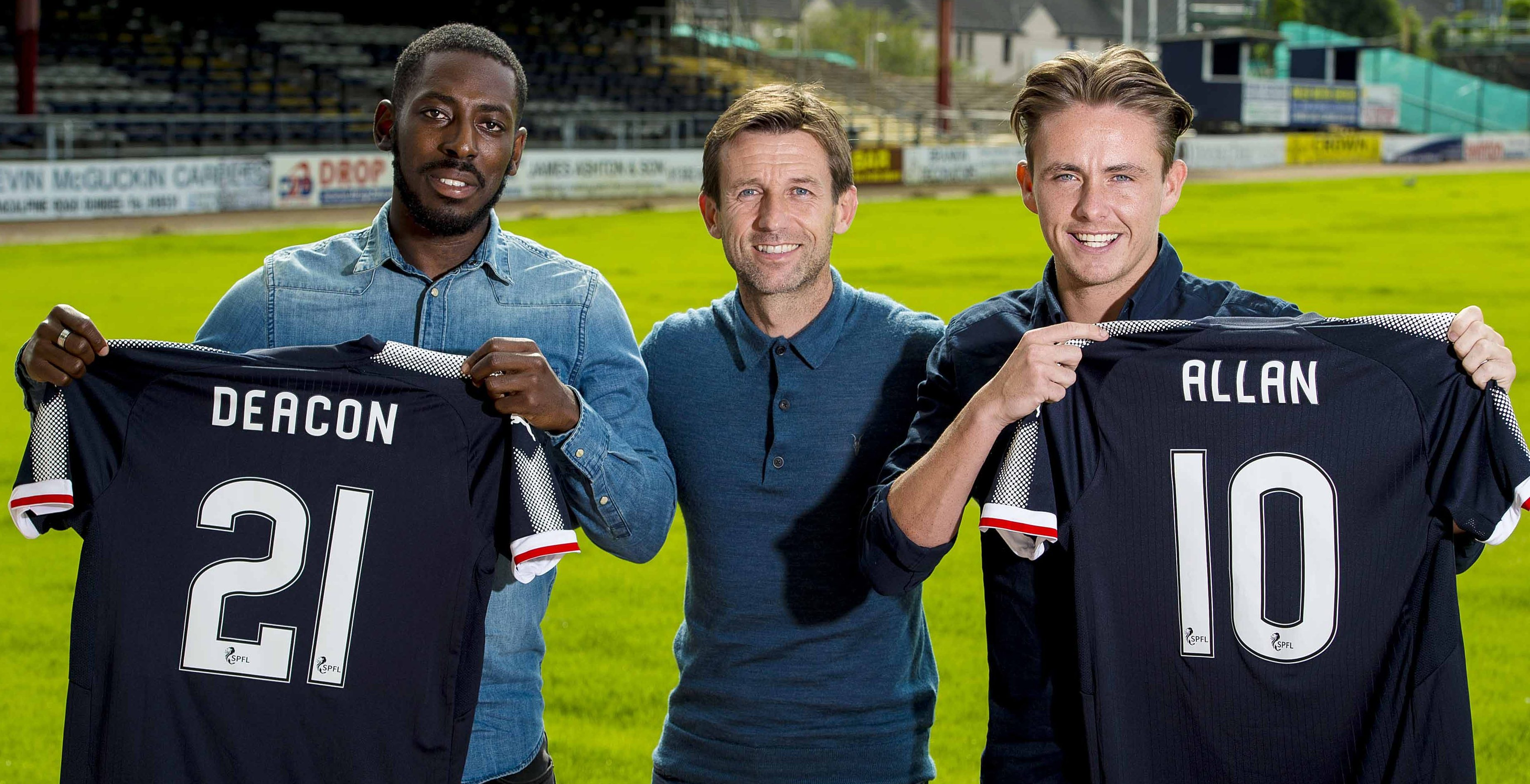 Neil McCann flanked by his two new signings.