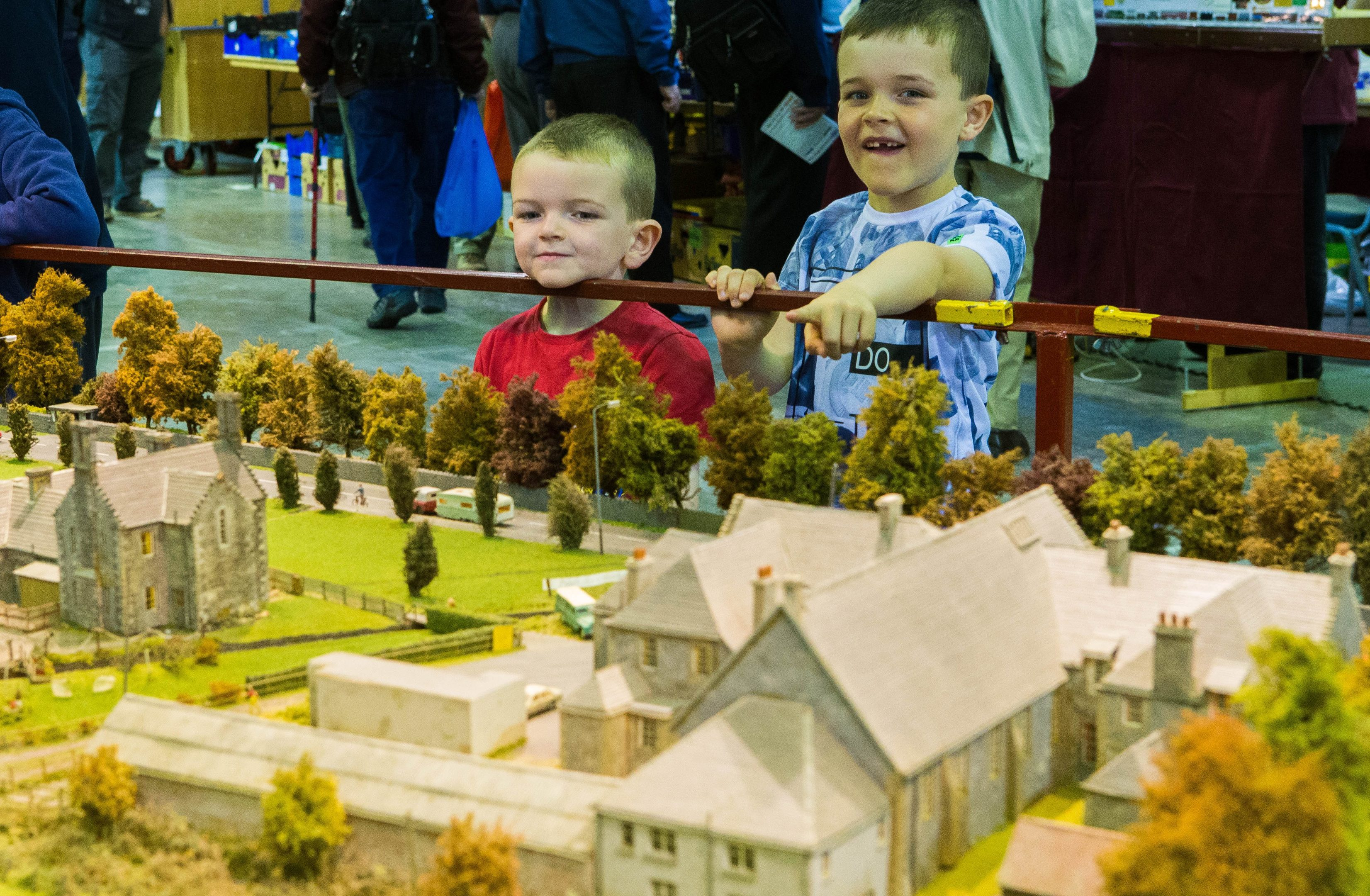 Conlan Turner (5) is shown the Blair Atholl rail model by brother Bryn Turner (6).
