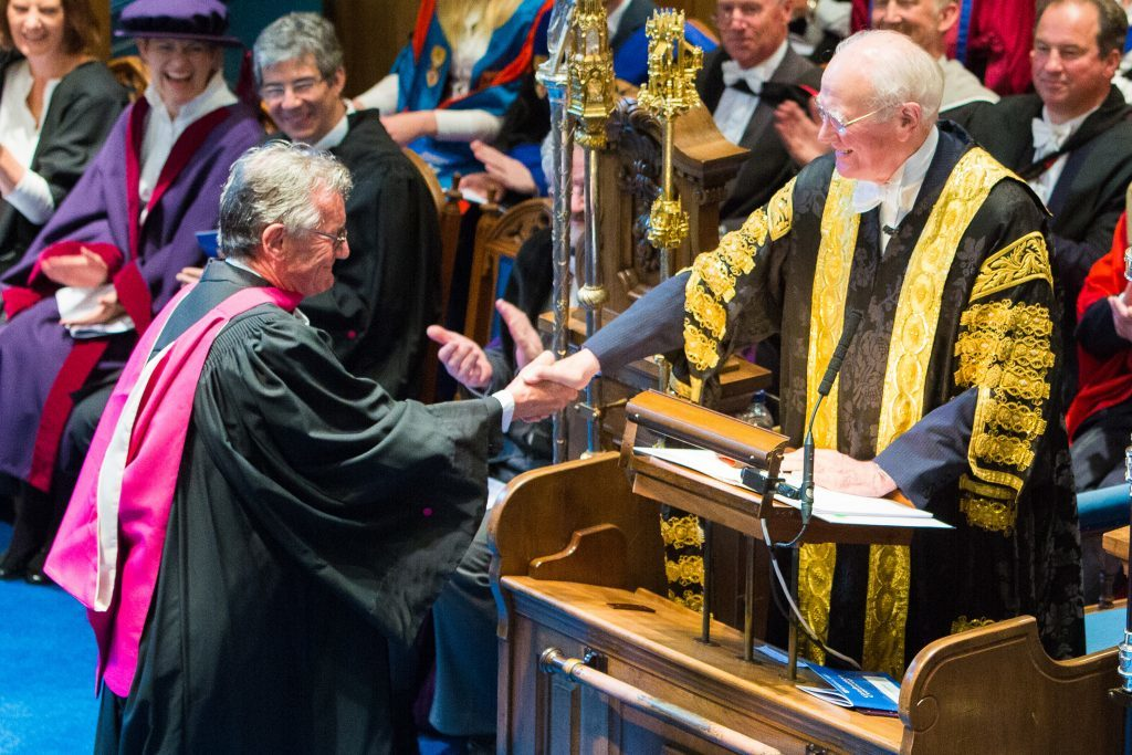 Michael Palin receives his Honorary Degree of Doctor of Science at St Andrews University, presented by Lord Campbell and Professor William Auston.