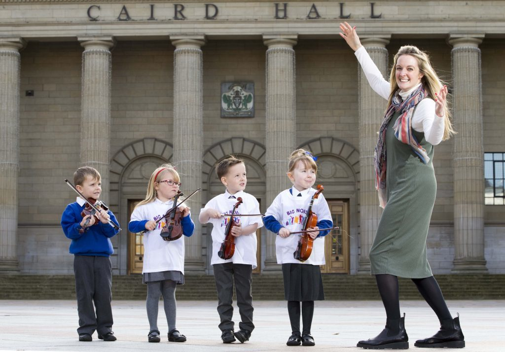 Ryan Mackenzie, Bella Riddell, Rhylee Traynor and Caitlyn Bertie with Sistema Scotland chief executive Nicola Keillan in May