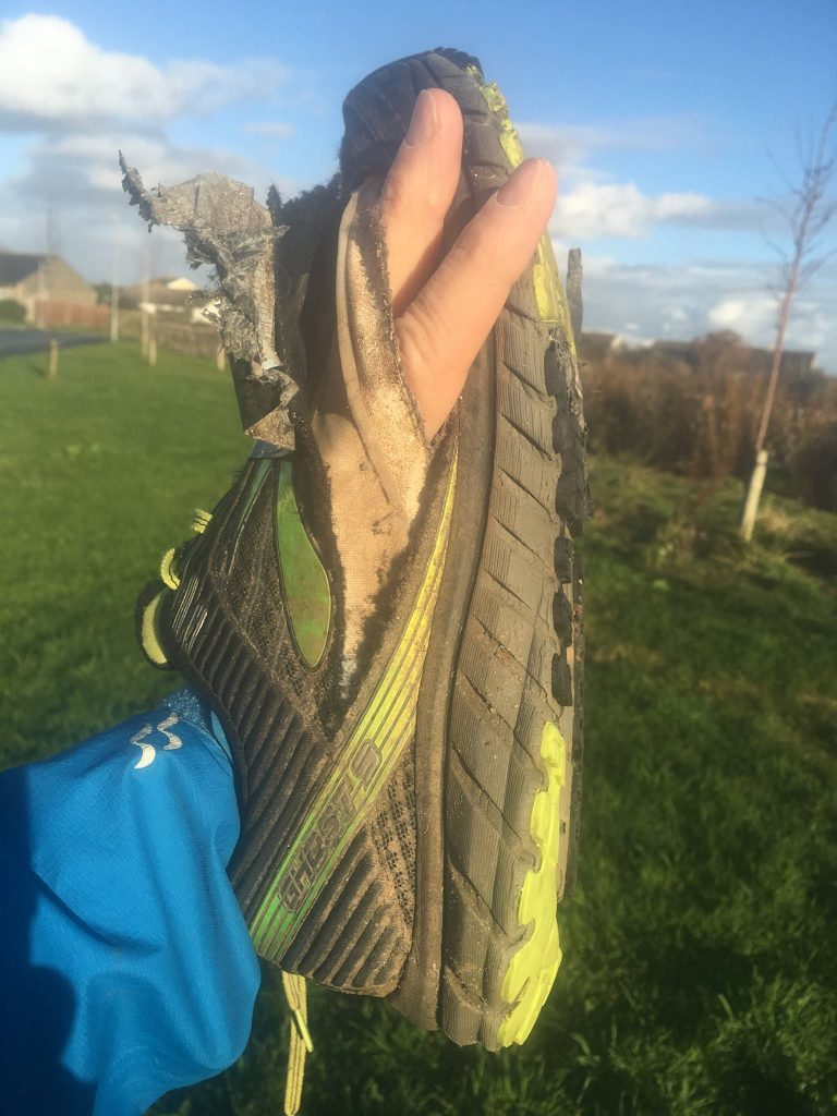 Simon's first pair of trainers, which were run-through after 881 miles.