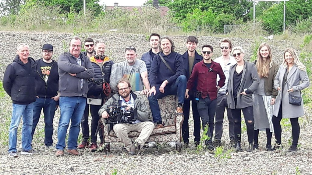 The cast and crew making the Courier advert, pictured on waste ground at Kingsway East, Dundee