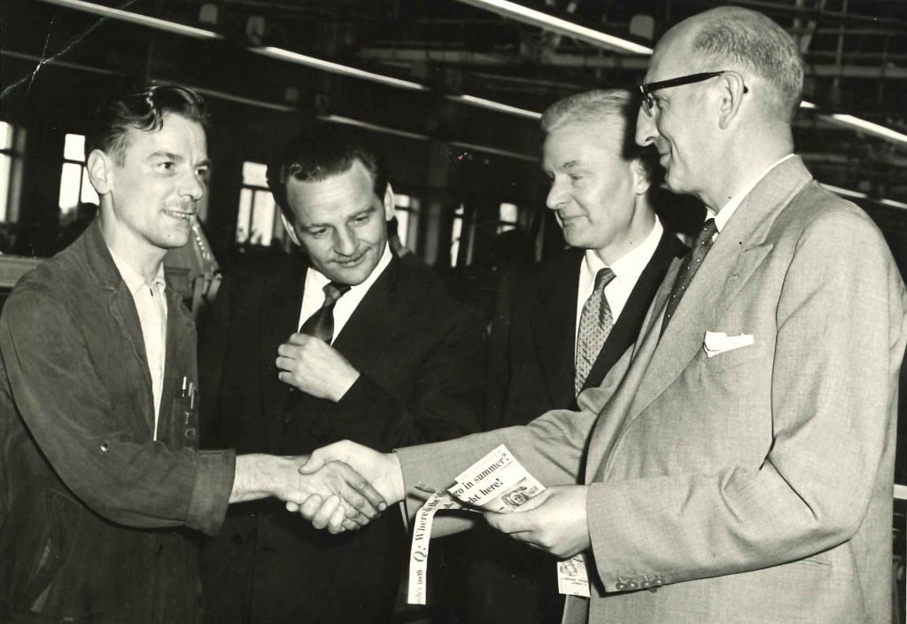 Jim Smith (left) being recognised by his then employer NCR after he saved the life of Barbara Cummings in 1958. Jim (left) with (from left) foreman F.W. Mallows, supervisor E.W. Schofield and senior executive assistant to the factory manager C.S. Webb.
