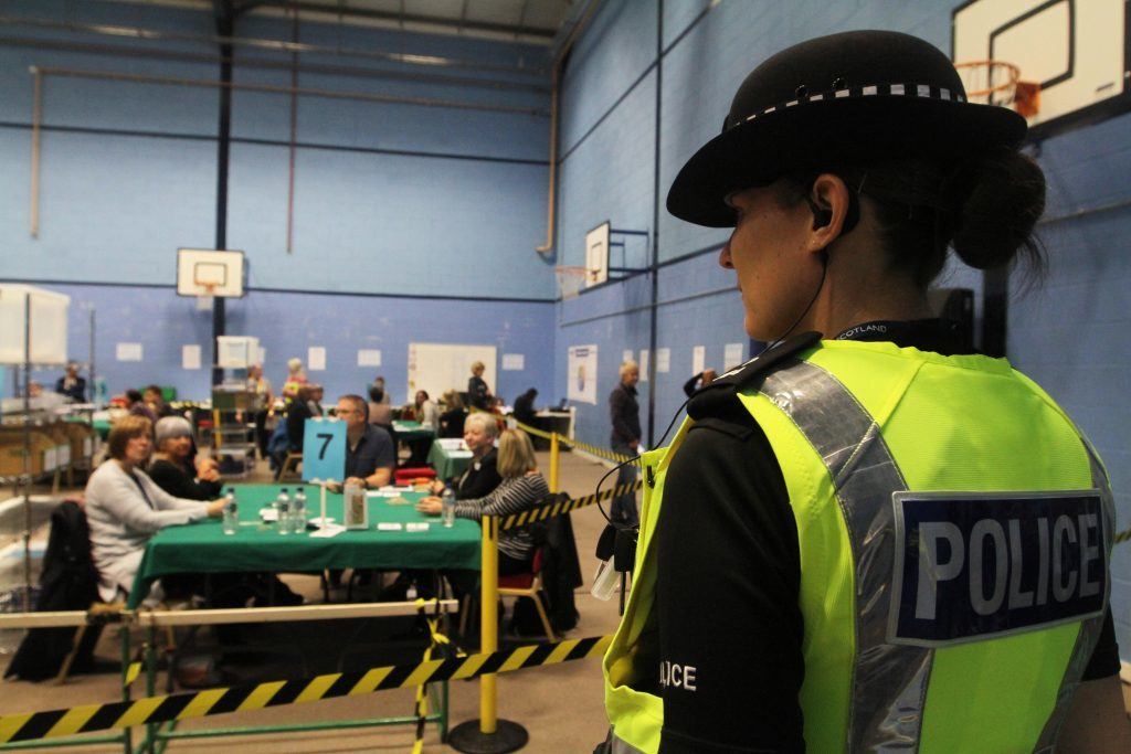 Police stand watch at the count.