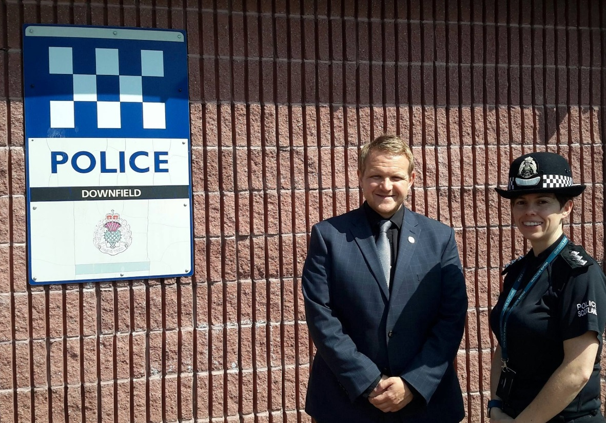 Mr Ross, pictured with area commander Nicola Russell, wants to ensure people know Dundee's streets are safe.