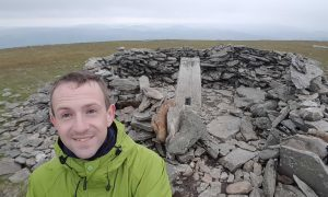 Mr Ogilvie at the top of Driesh during his munro challenge.