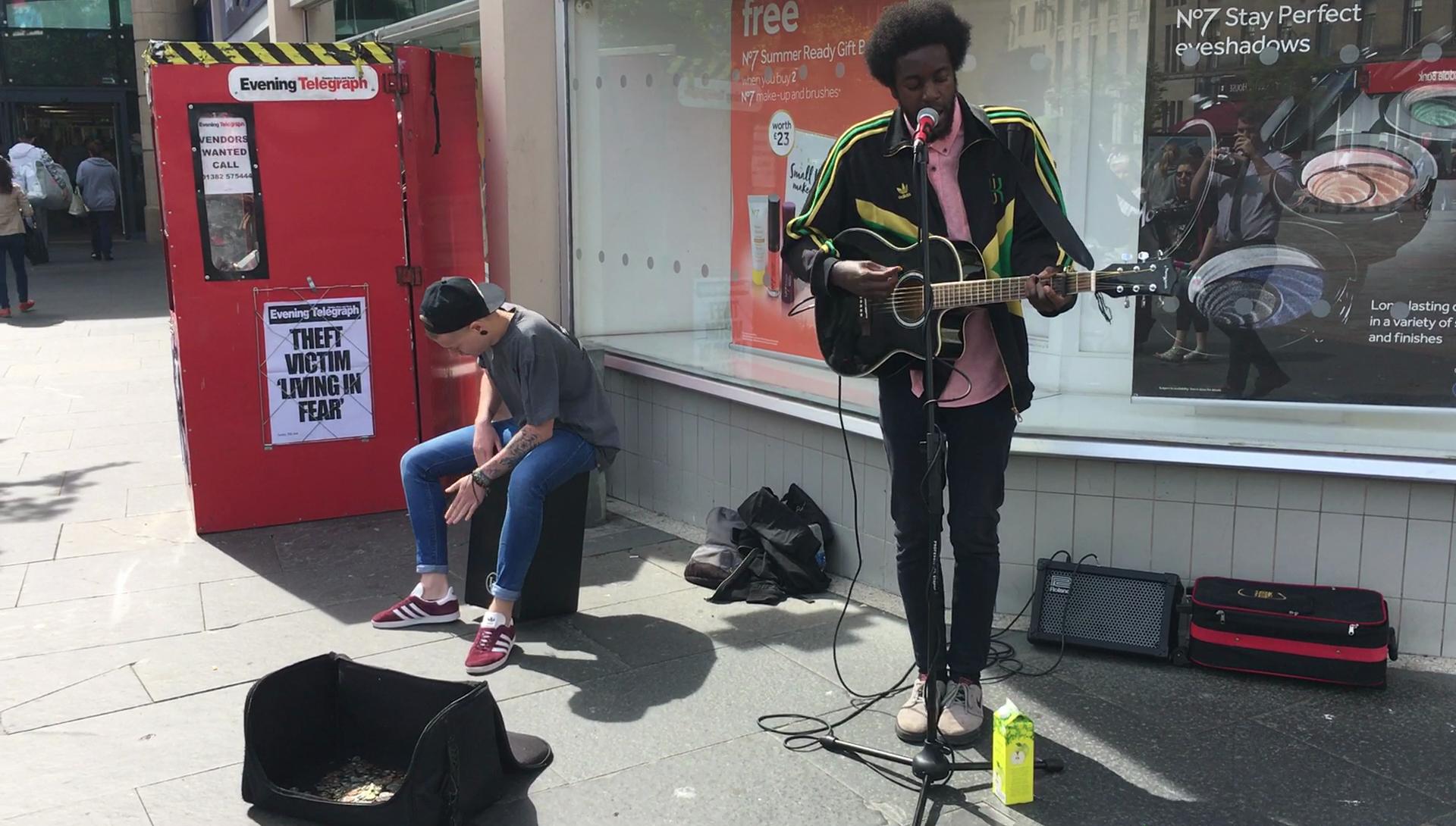 Brandyn Murphy and singer-guitarist James Liandu in Dundee City Centre.