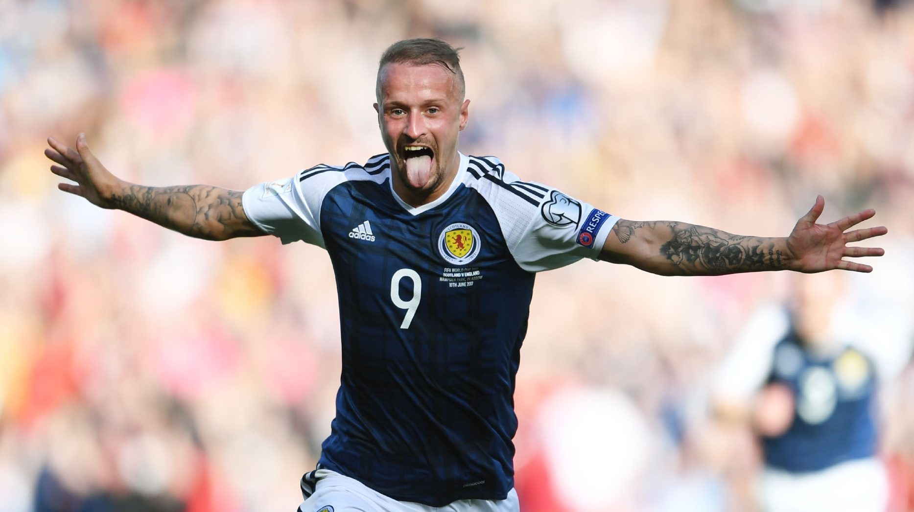 Leigh Griffiths celebrates scoring his second freekick.