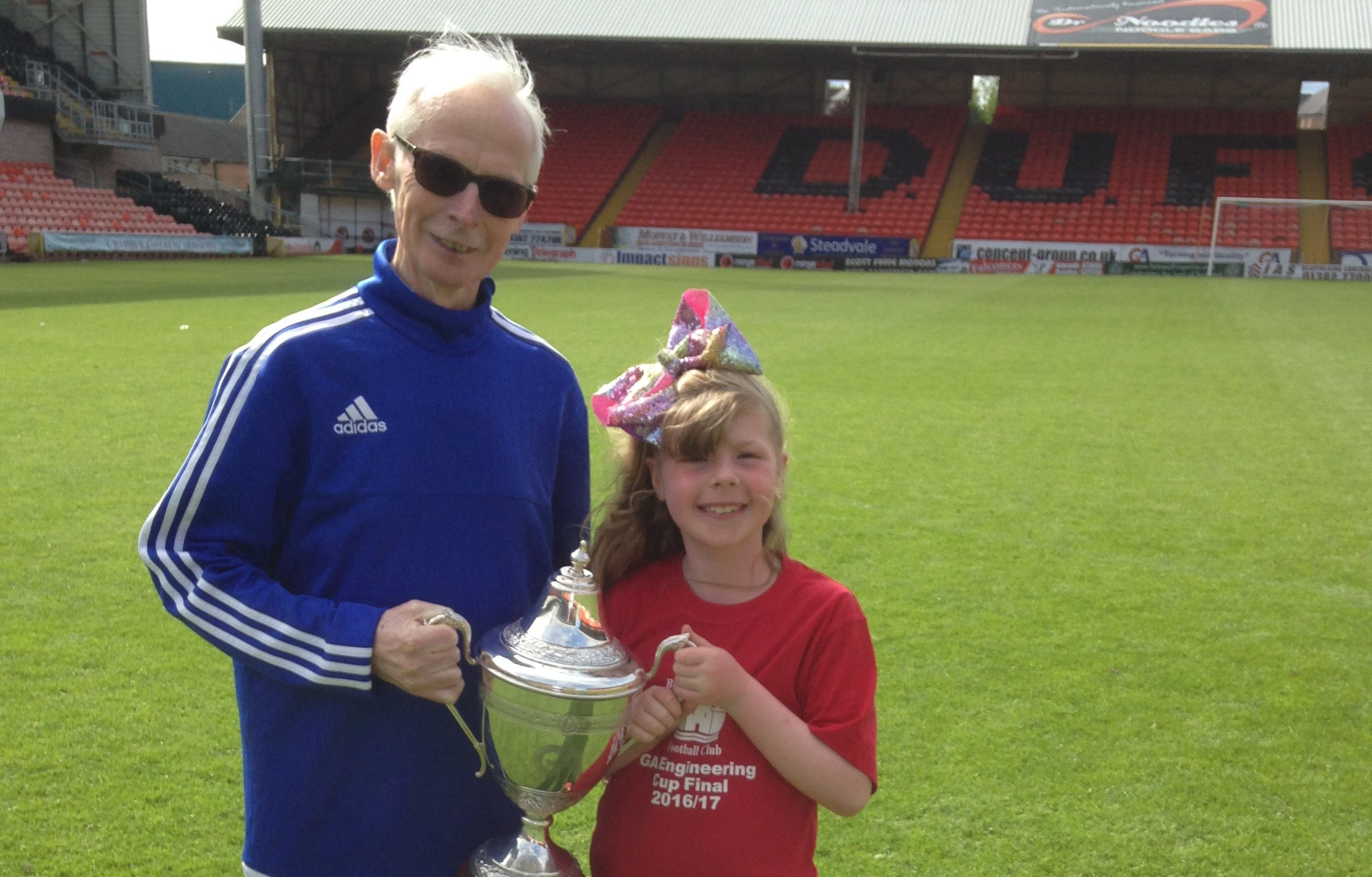 Sandy with his grand-daughter Alix at Tannadice.