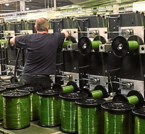 A technician works on the new synthetic grass yarn line at Don & Low in Forfar
