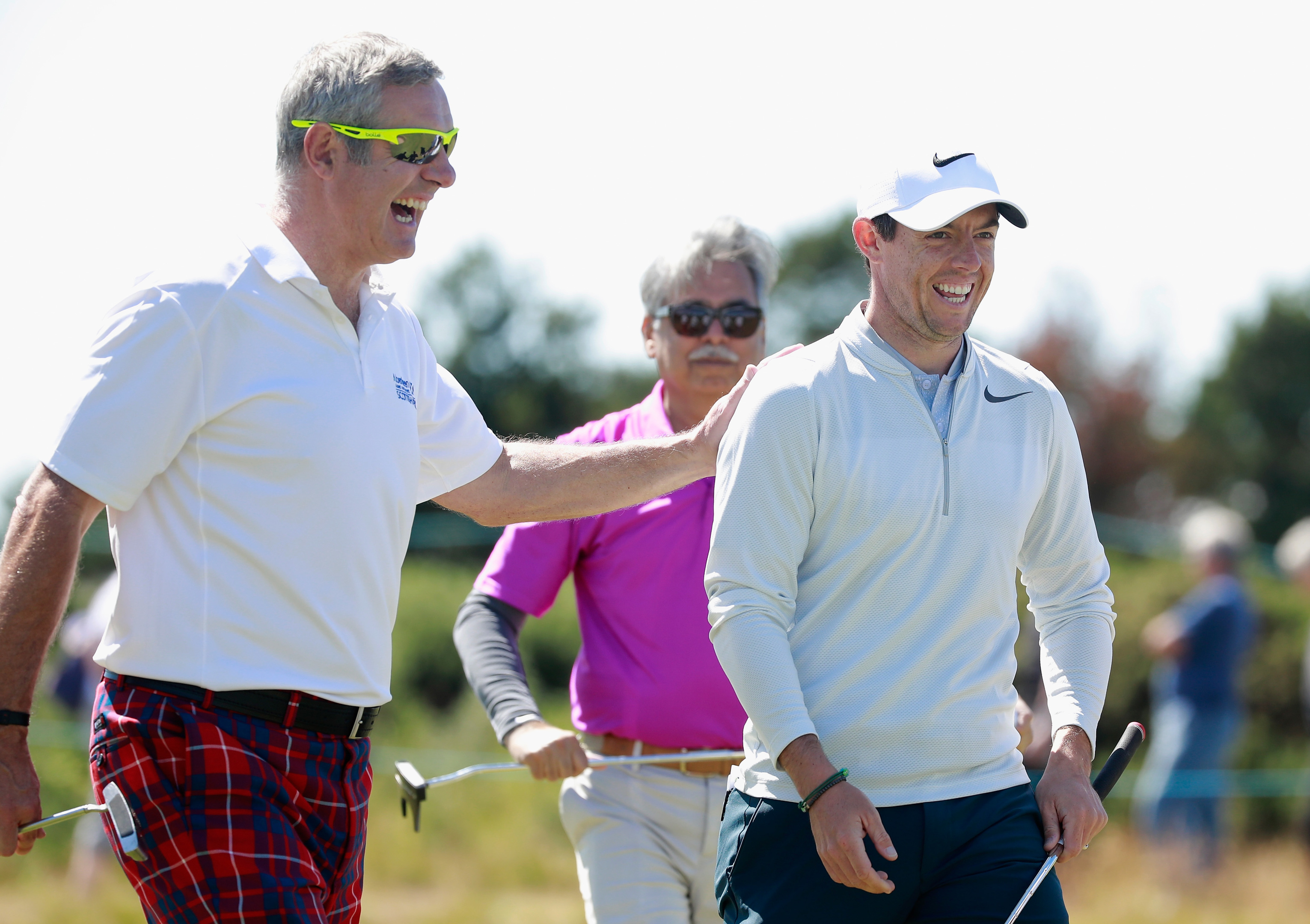 Rory McIlroy and former Sctoland and Lions caotain Gavin Hastings enjoying the Scottish Open pro-am at Dundonald Links.