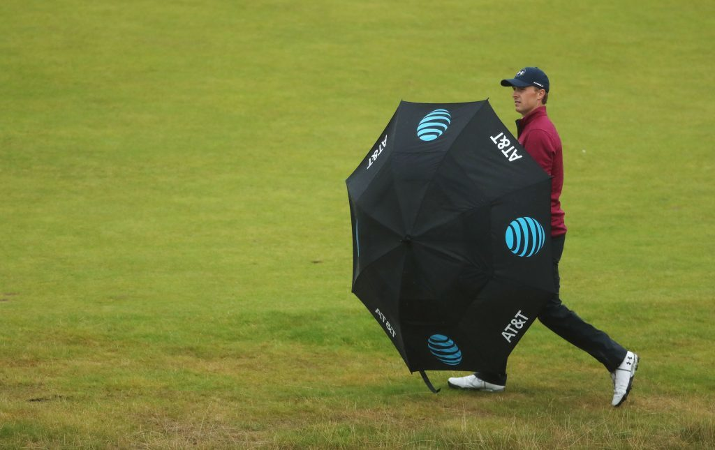 Jordan Spieth shelters from the rain under an umbrella during the second round at Royal Birkdale.