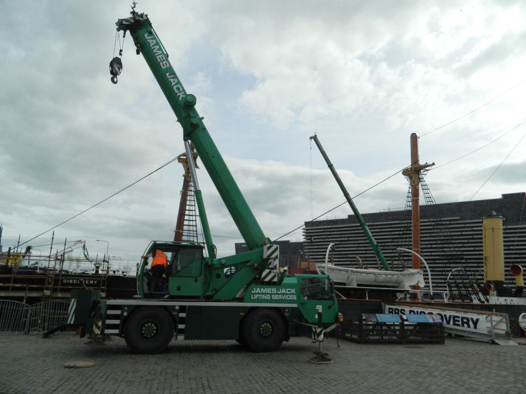 A crane arriving on site.