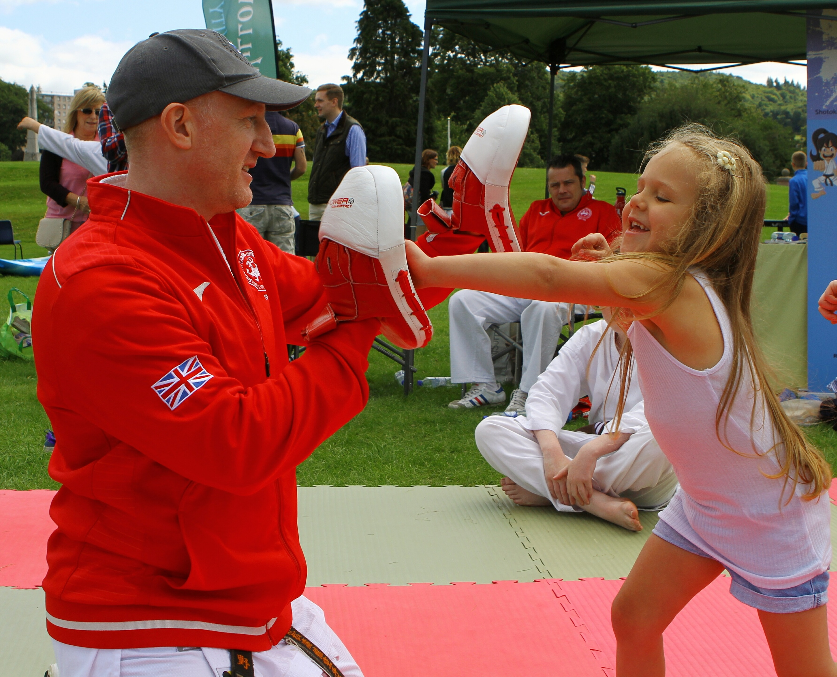 Lilly Keenan, age 5, trying out the boxing on the Perth Shotokan Karate Academy, with instructor Mark Lewis, at the ActiviTAY event, at the North Inch in Perth.