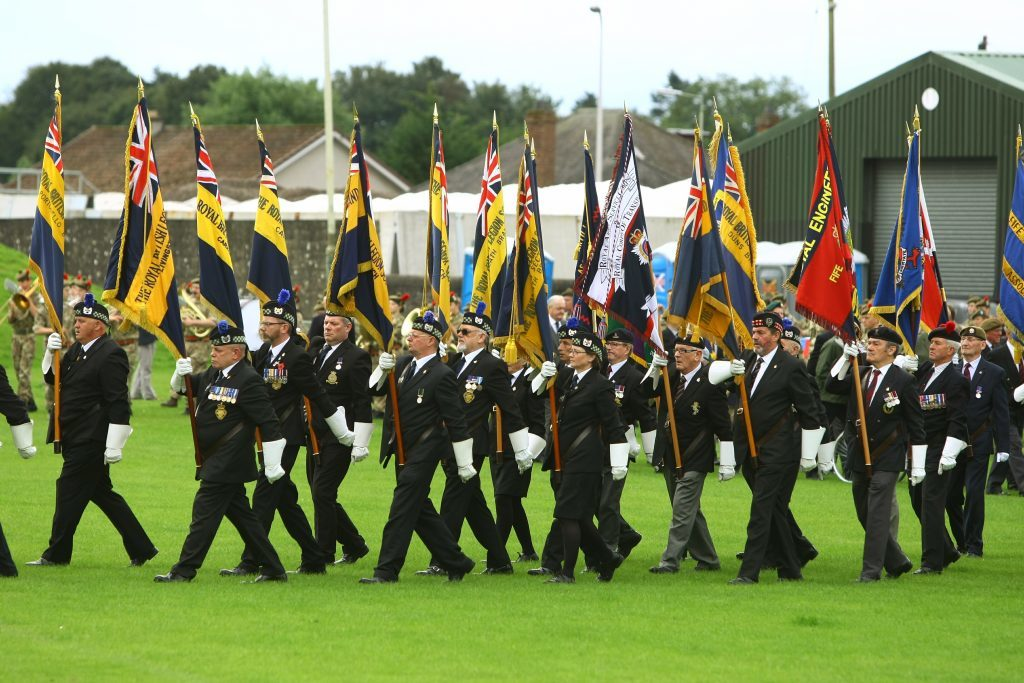 The British Legion standard bearers march into Market Park.
