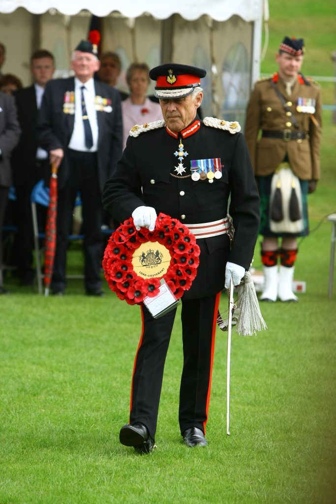 Brigadier Mel Jamieson goes to lay his wreath at the parade and Drumhead Service.