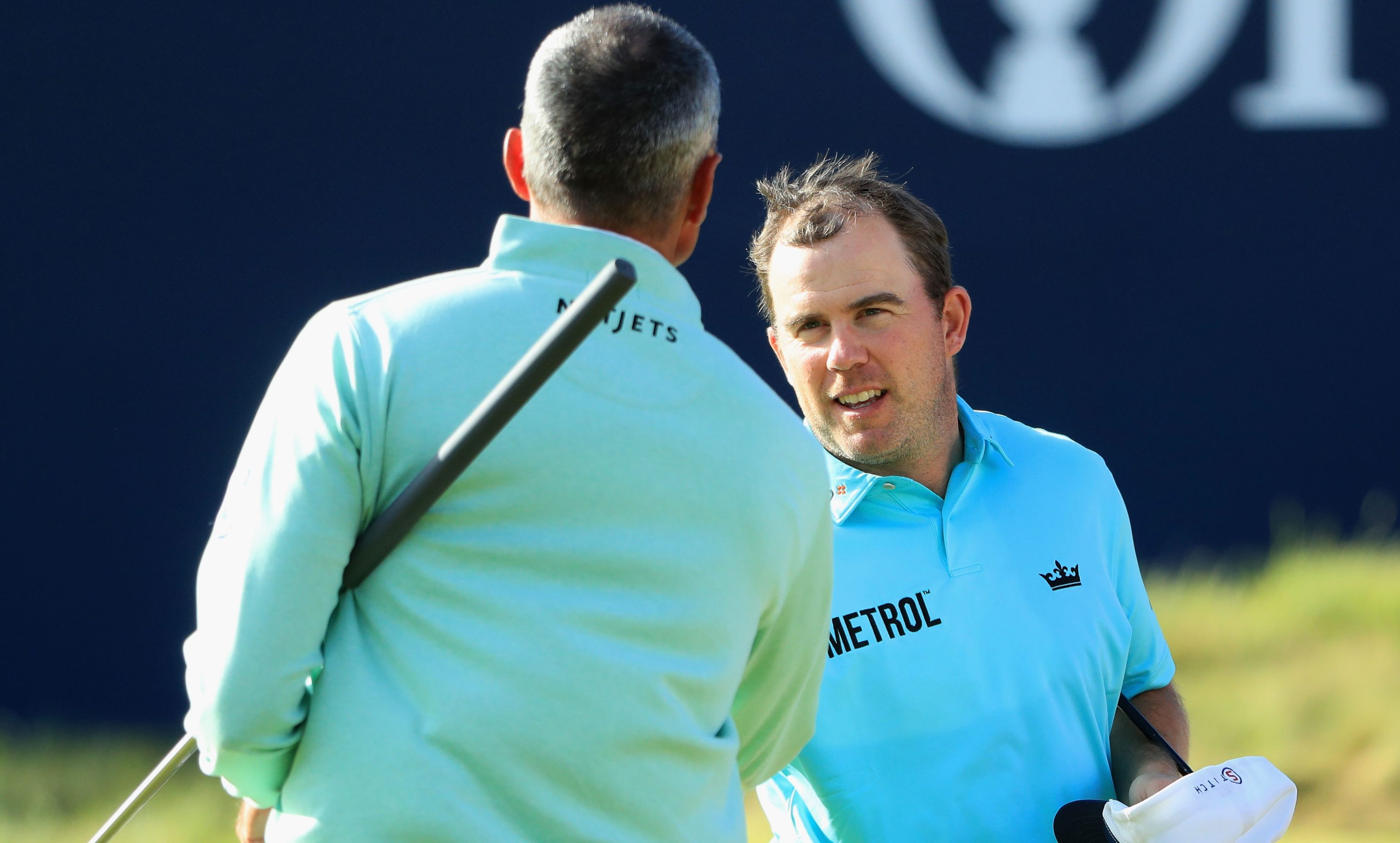 Richie Ramsay shakes hands with Matt Kuchar after their opening round.