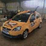 Cow car designer gets pat on the head from rally bosses