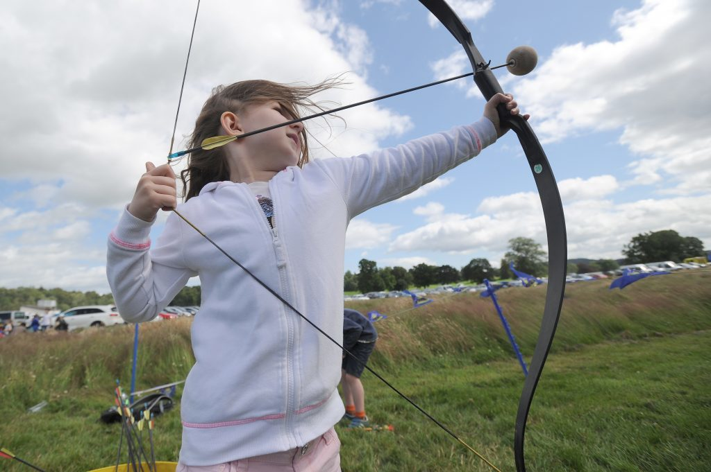 Action from the Flu Flu Archery - Erin Harty (6) tries her hand.