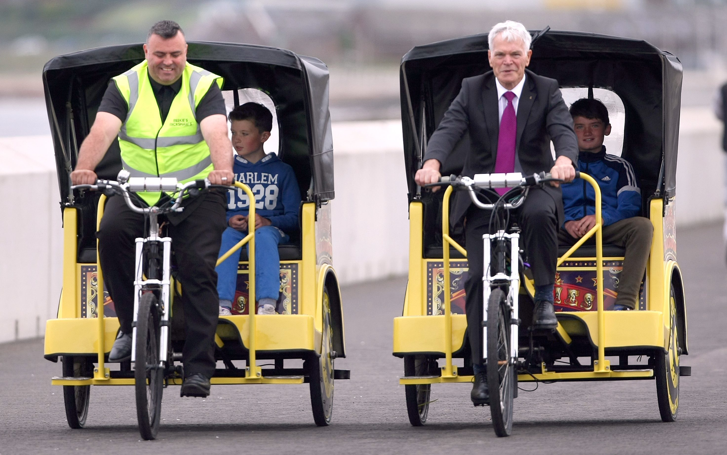 Tyrone Reekie cycling his rickshaw with Councillor Rod Cavanagh.
