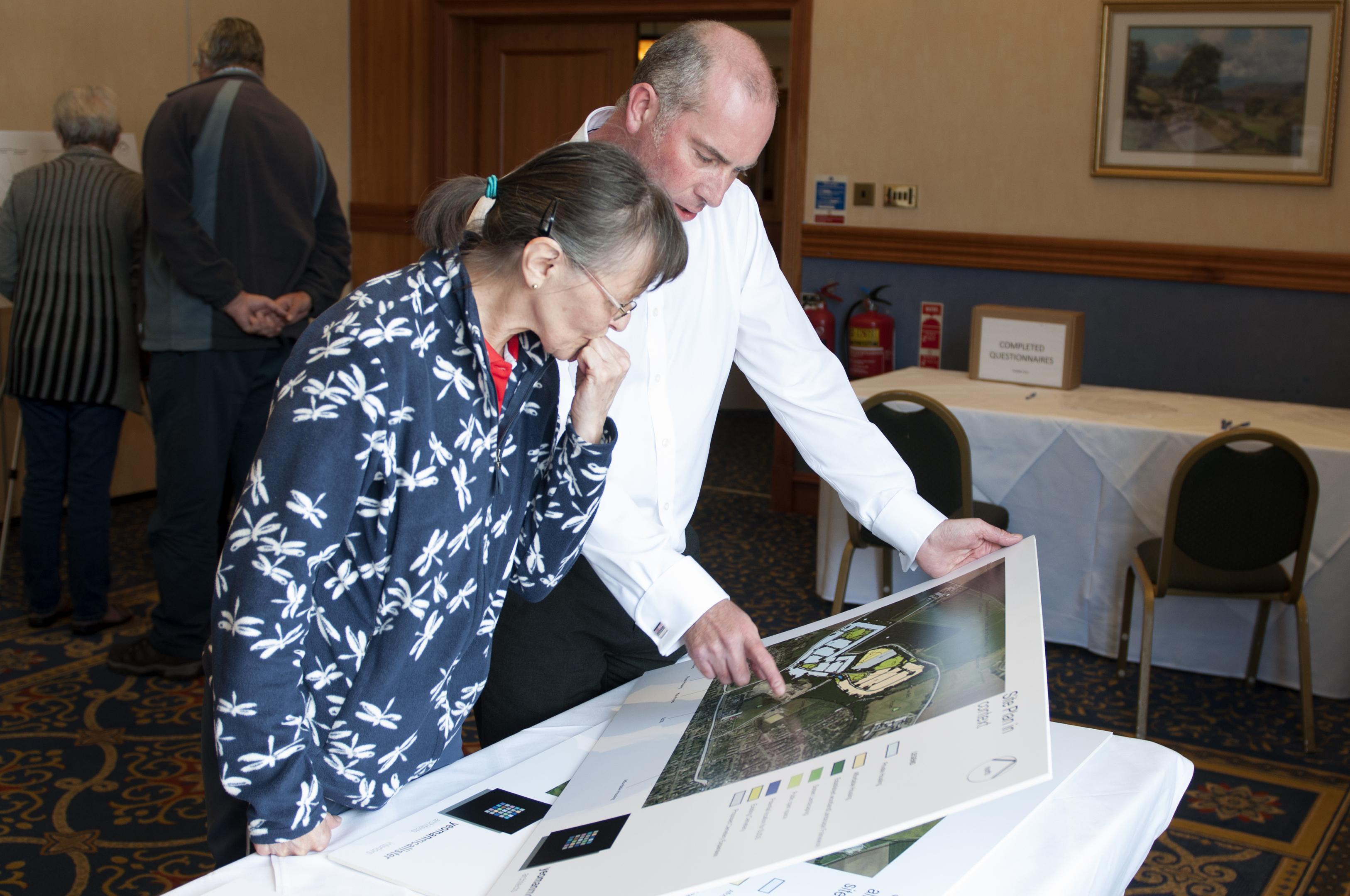 Gladys Noble and planning consultant from Rick Finc Associates Stuart Szylak.
