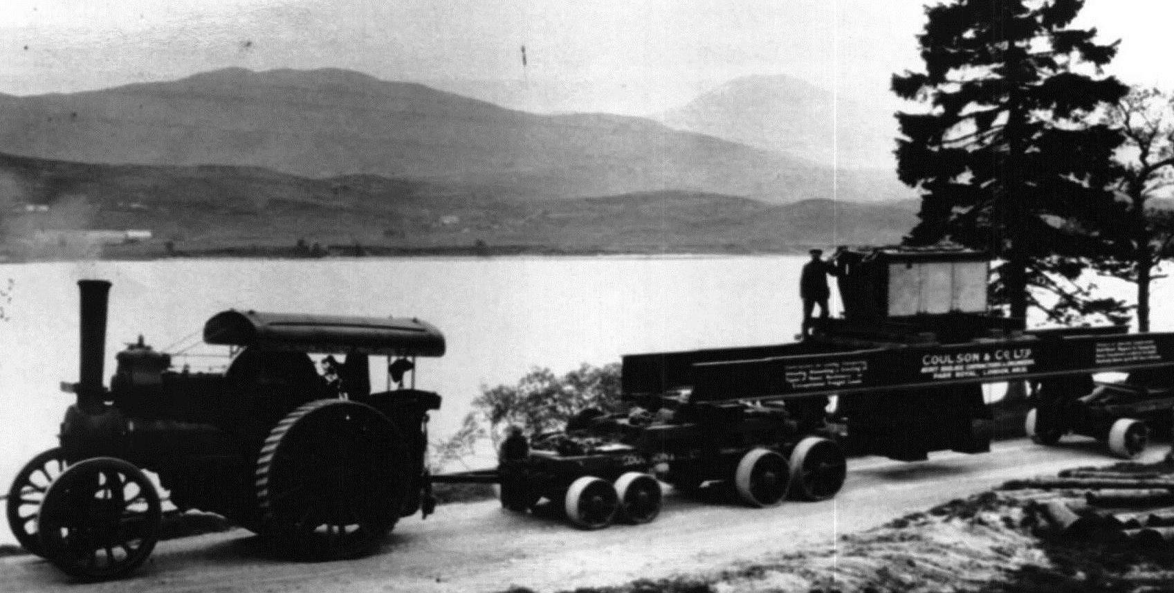 A steam engine delivers a transformer to Rannoch in the 1930s.