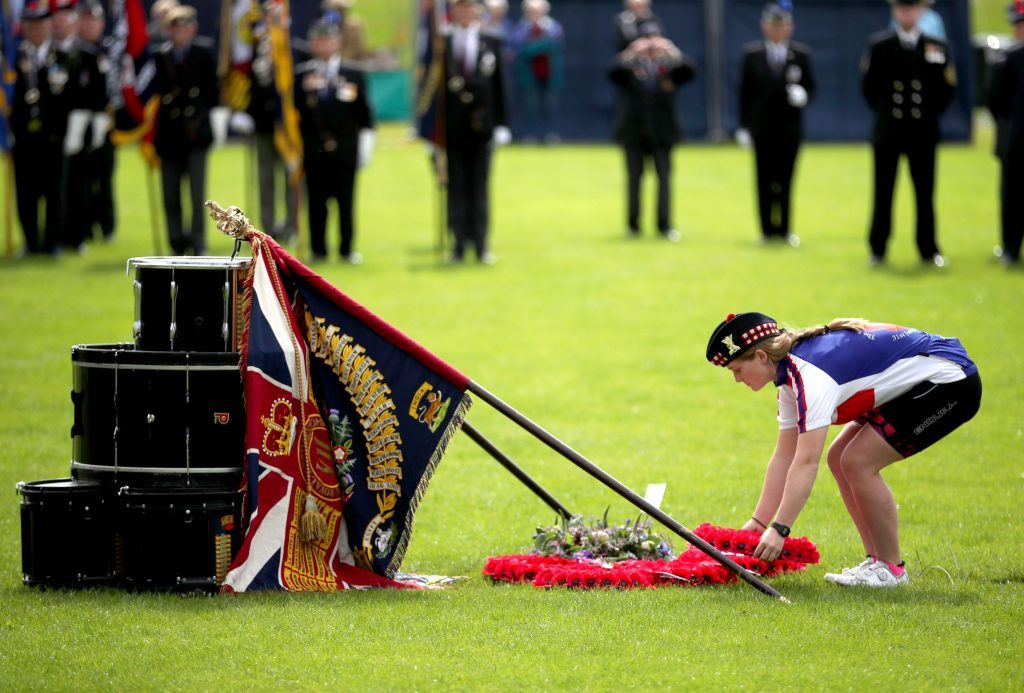 Officer cadet Emily Whyte, 20, from Glasgow, lays a wreath by the drum altar.