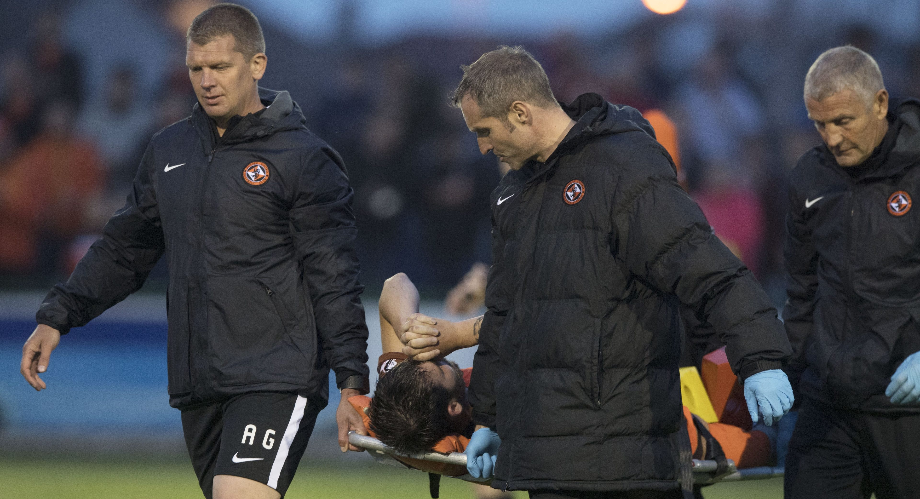Dundee United's James Keatings is stretchered off at Buckie.