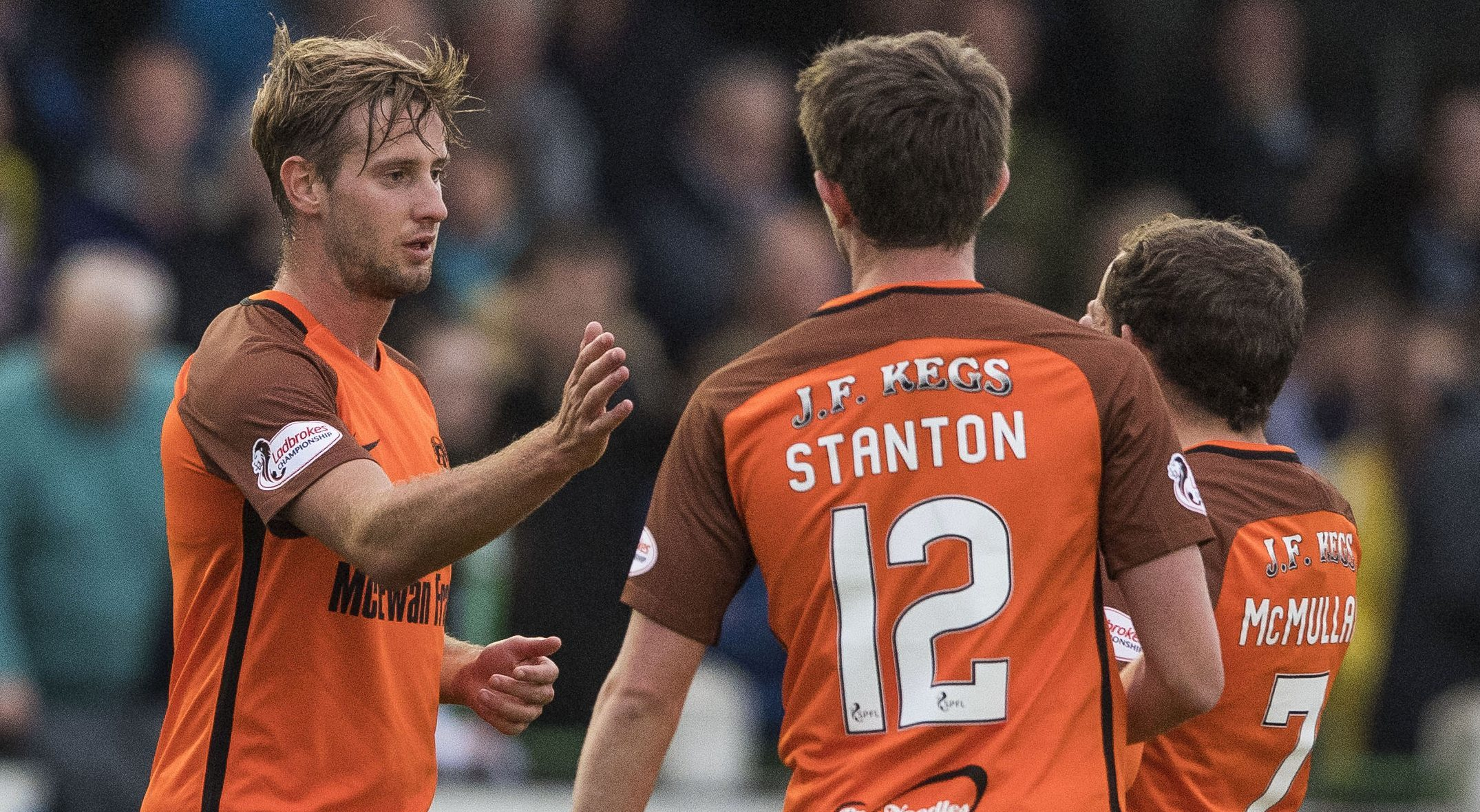 Billy King celebrates his goal against Buckie with his team-mates.