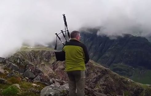 A lone piper plays on  Buachaille Etive Mòr. Credit: Bruce Melrose on Youtube.