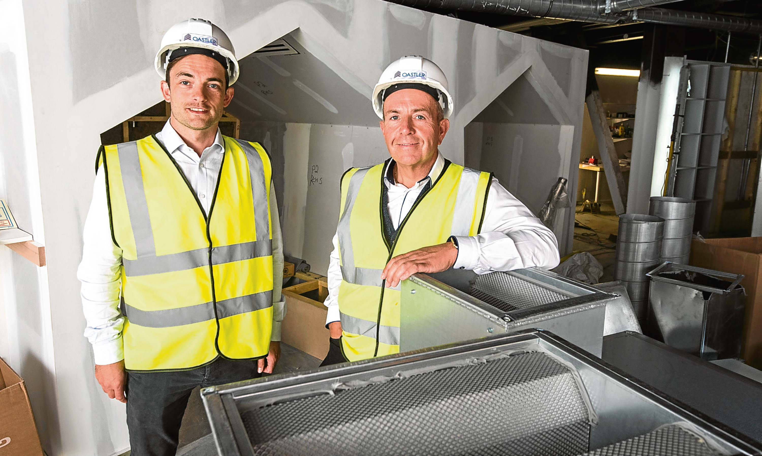 Brian McNicoll, enterprise and entrepreneurship manager at Dundee University with Professor Gary McEwan at the soon-to-be completed Elevator hub in Dundee.