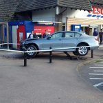 BMW stranded after hitting bollards outside Tesco