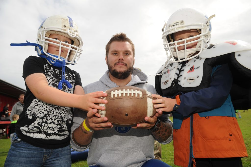 Trying out American Football on Beacon Green were l to r - Brogan Taylor (7), Conar Taylor (Hurricanes team member) and Harry McMaster (5), Arbroath.