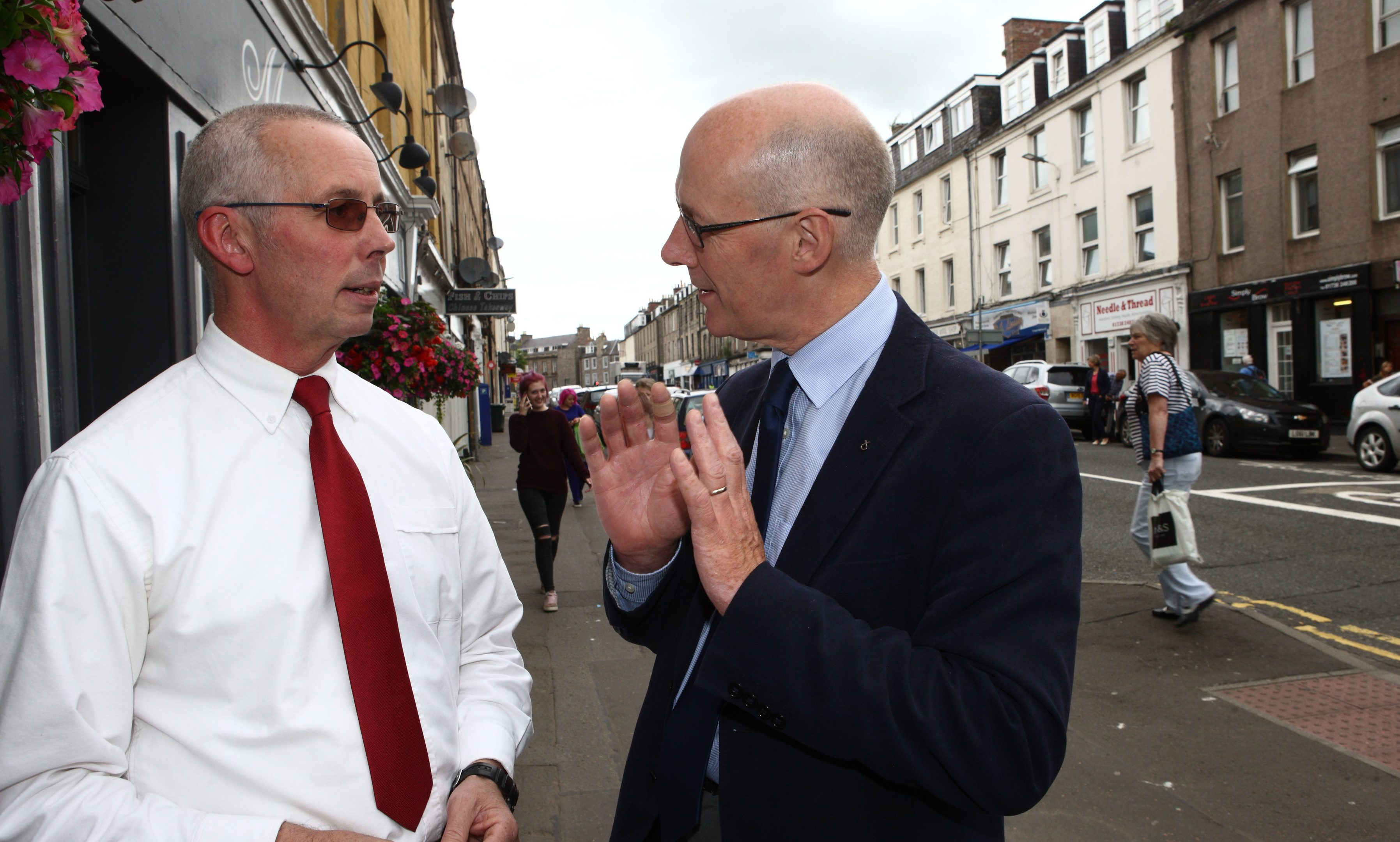 Deputy First Minister John swinney MSP tours N Methven St in Perth with Keith Fergie
