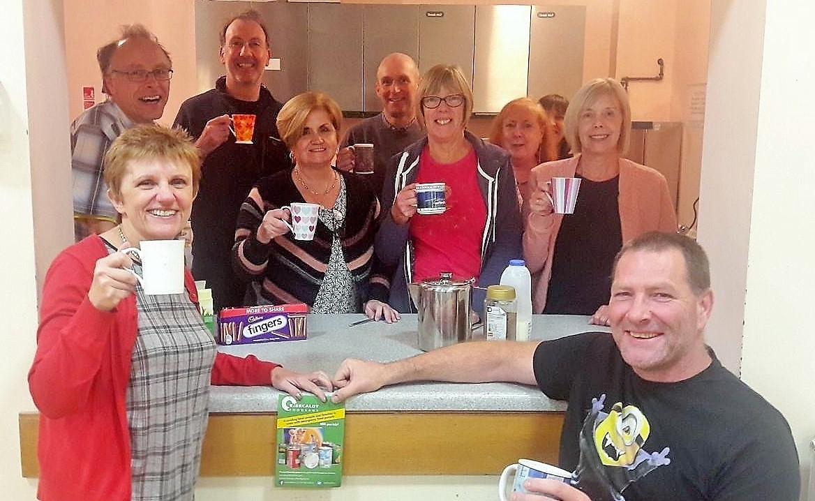 Volunteers at Kirkcaldy Foodbank supporting the new campaign to give up a cup of takeaway coffee and instead donate the cash.
