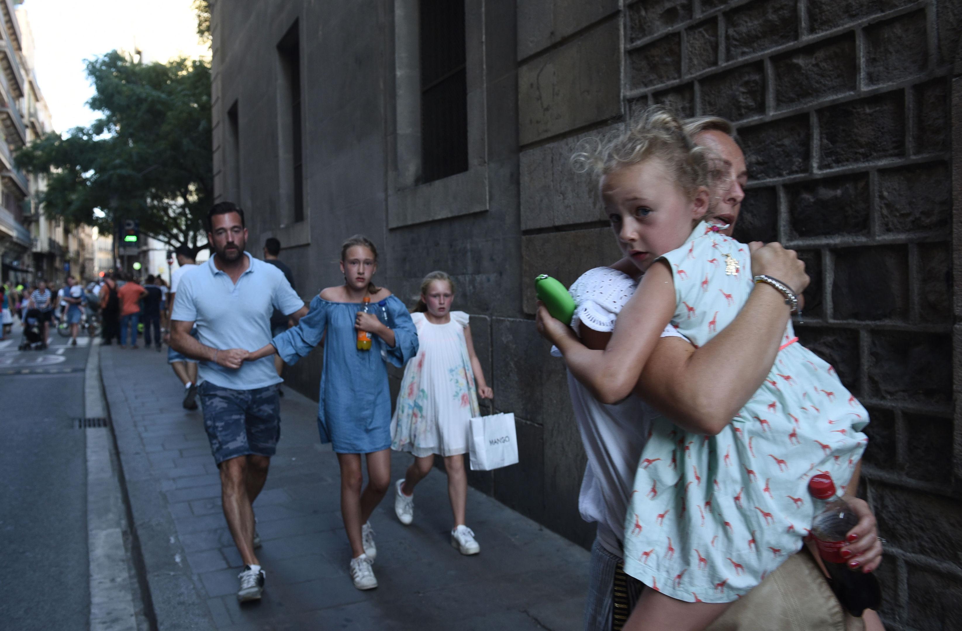 People flee the scene in Barcelona, Spain.