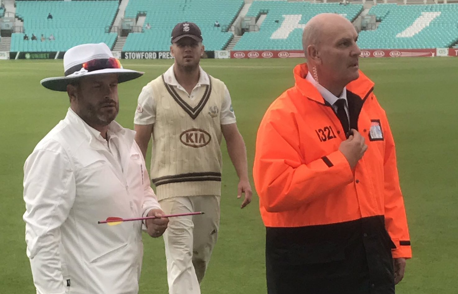 Picture taken with permission from the twitter feed of @topmanjem of a match official holding an arrow that was fired on to the pitch at the Kia Oval during a County Championship clash between Surrey and Middlesex.