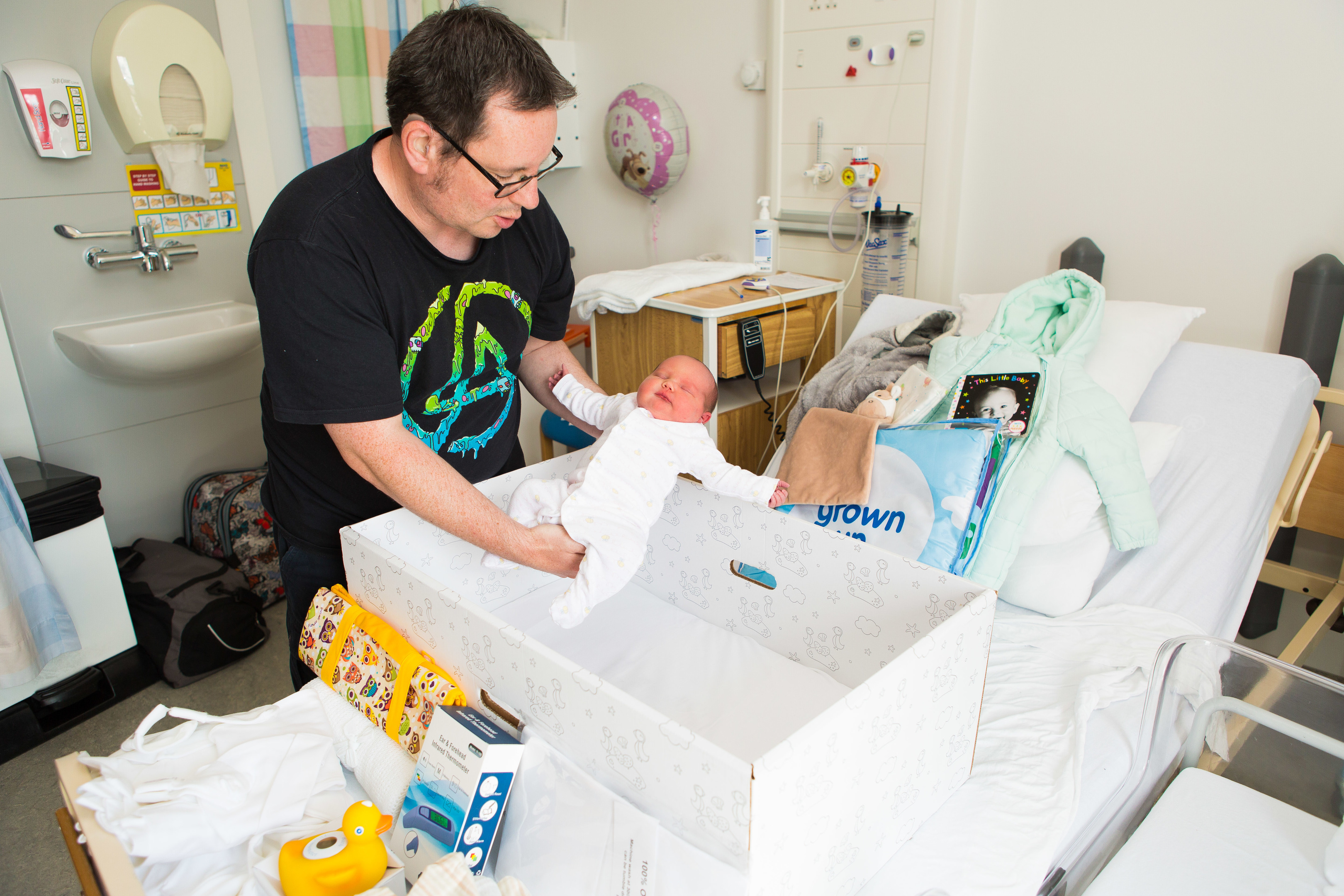 Baby Emma-Lily and her father Lee Hughes (40) try out the first baby box to be delivered to Fife.