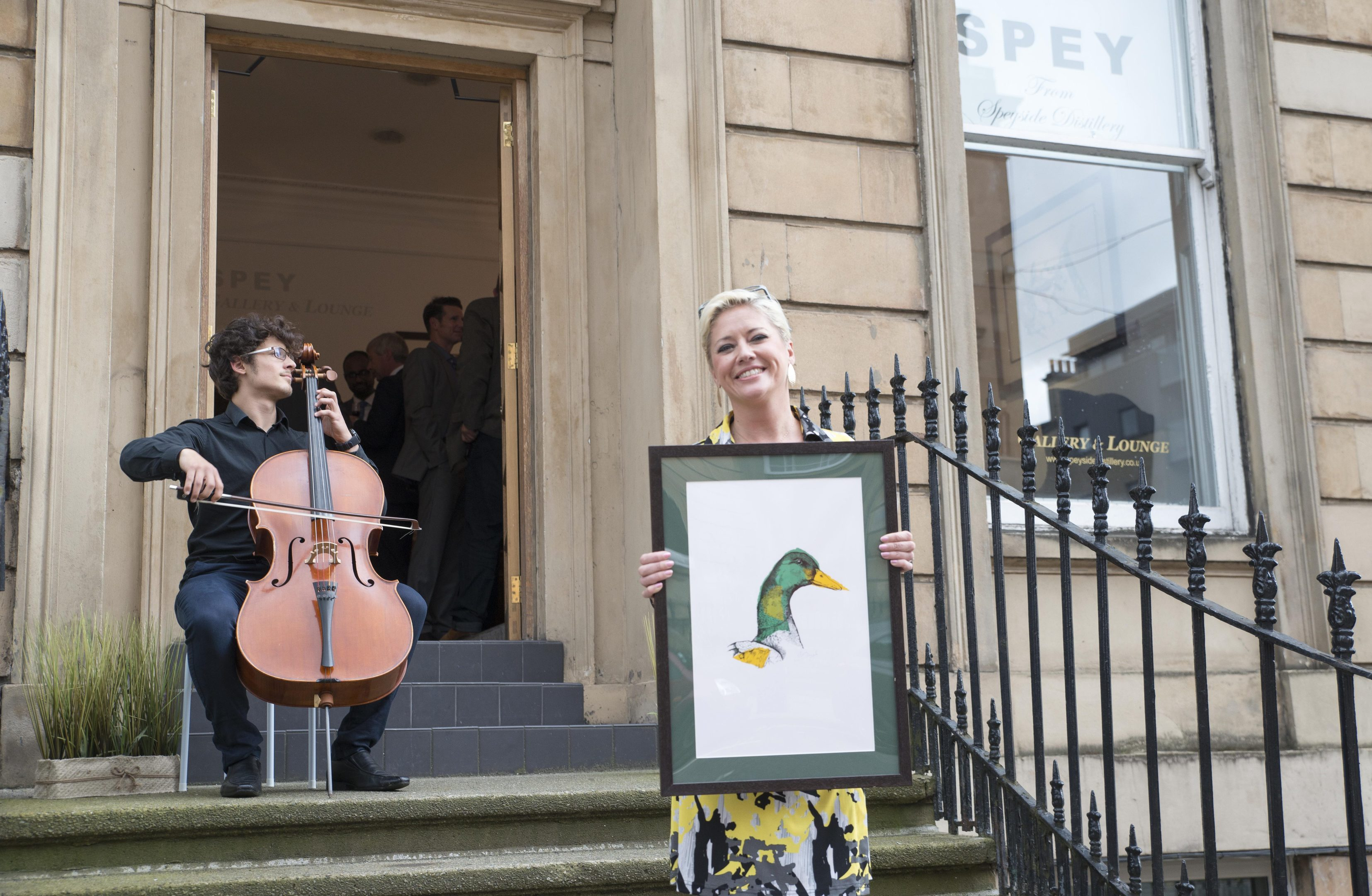 Joanna McDonough, Artist in Residence at Speyside Distillery, in front of the new SPEY Gallery and Lounge on Bath Street, Glasgow.