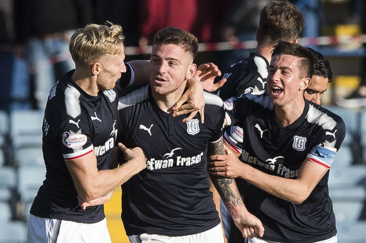 Kerr Waddell celebrates his winner against Hearts in the last league game at Dens.