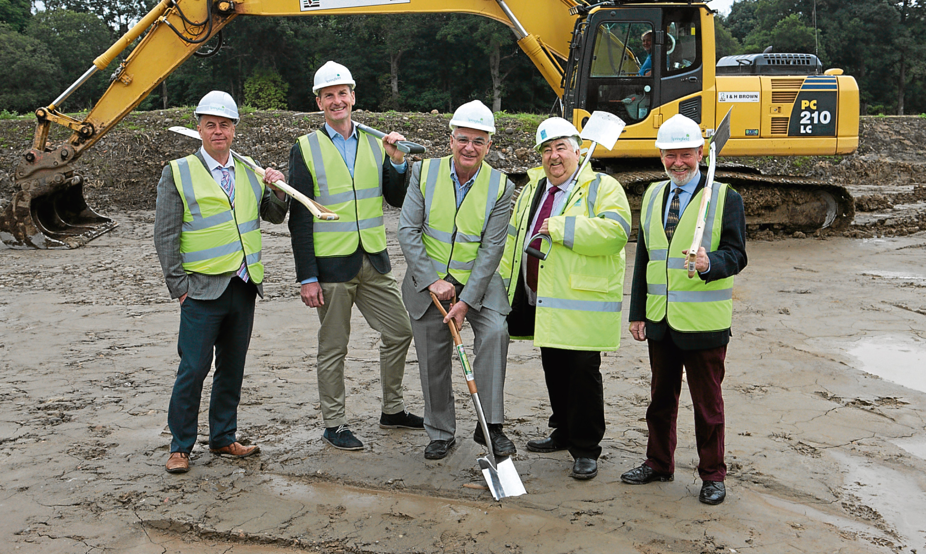Springfield chairman Sandy Adam (centre) at the ground cutting ceremony for Bertha Park last month.