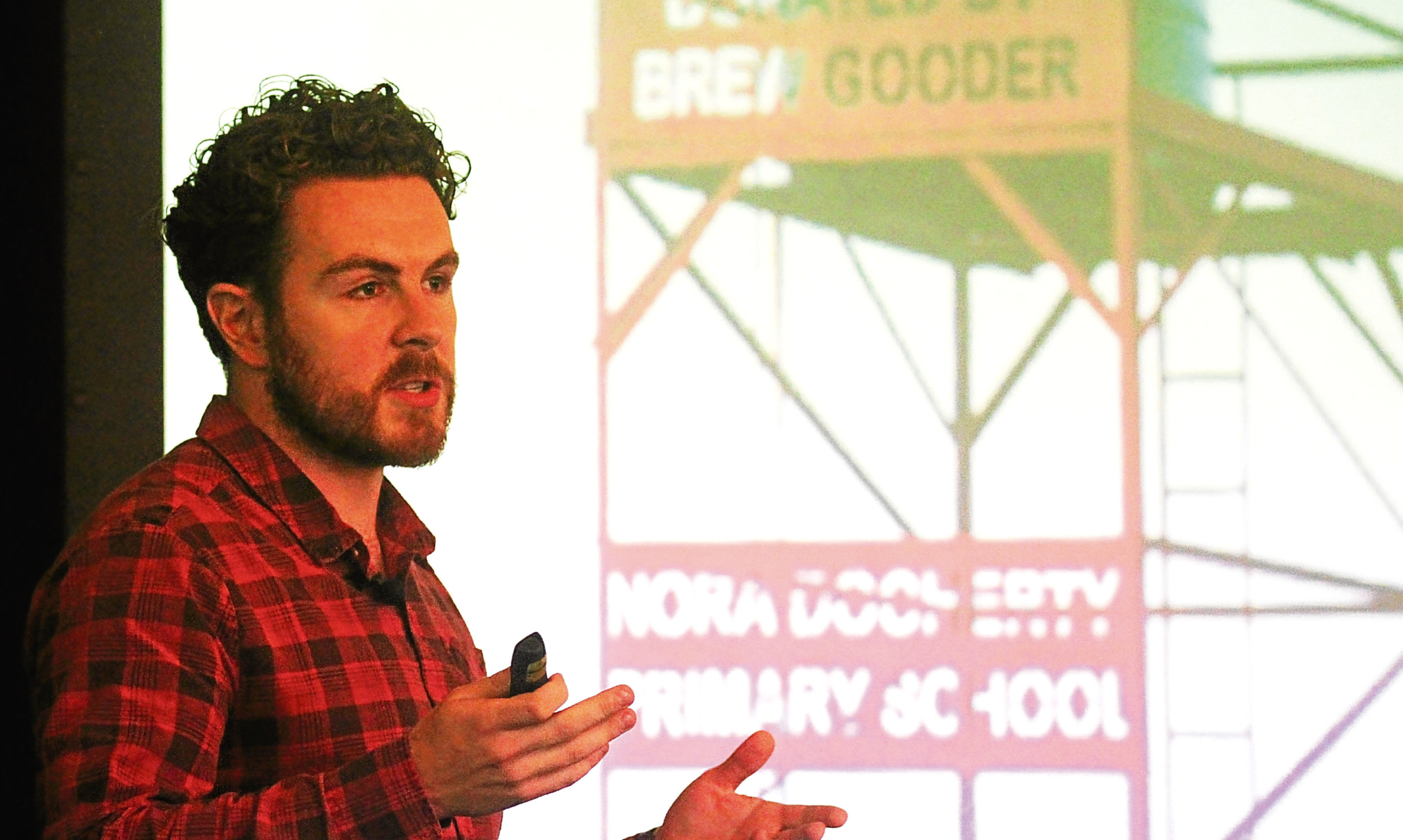 Alan Mahon of Brewgooder speaking at the business lunch