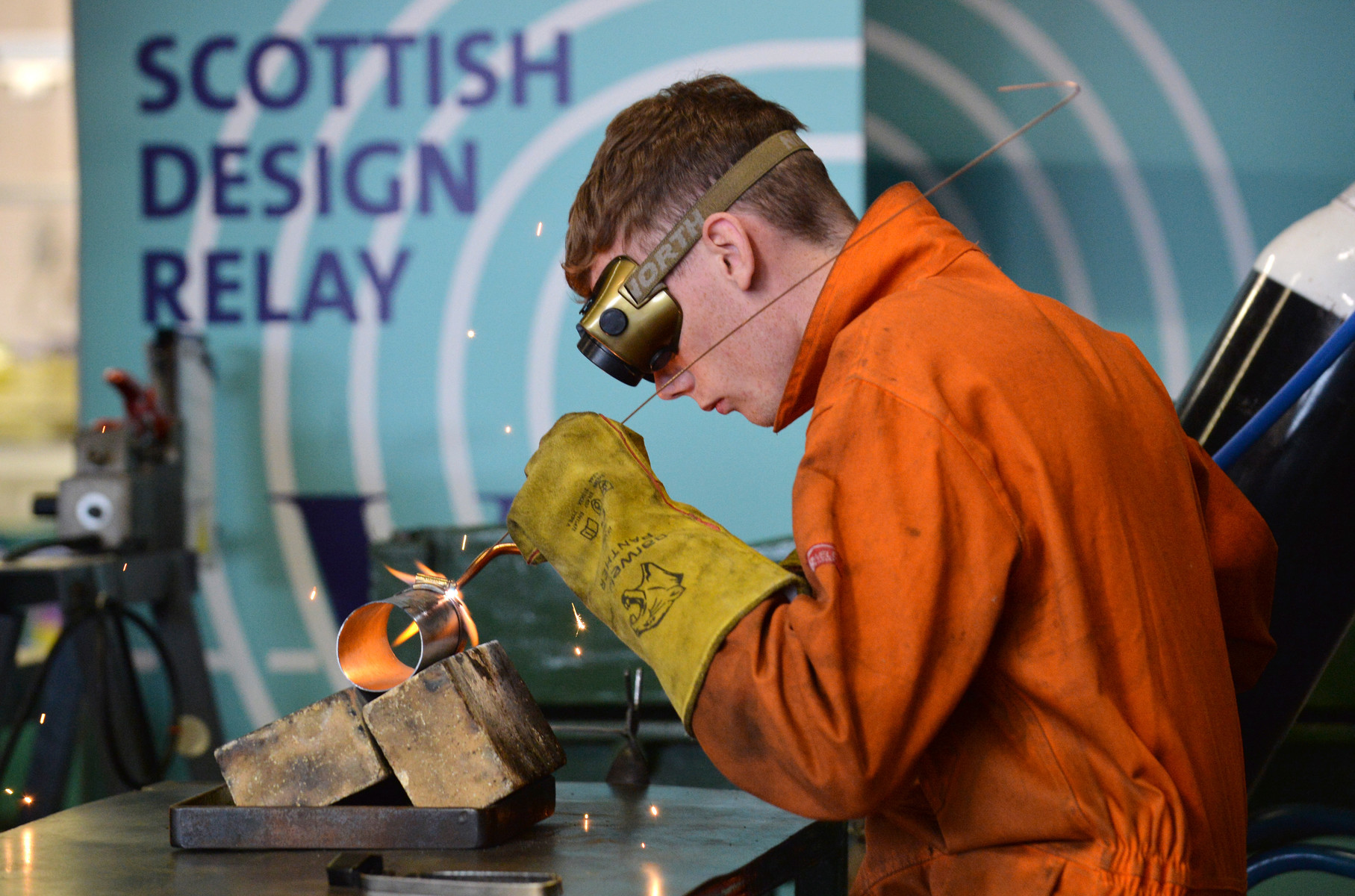 Michelin apprentice engineer Glenn Wheelans welds a piece of rolled metal plate to form part of the outer casing of the final prototype. Photo by Julie Howden