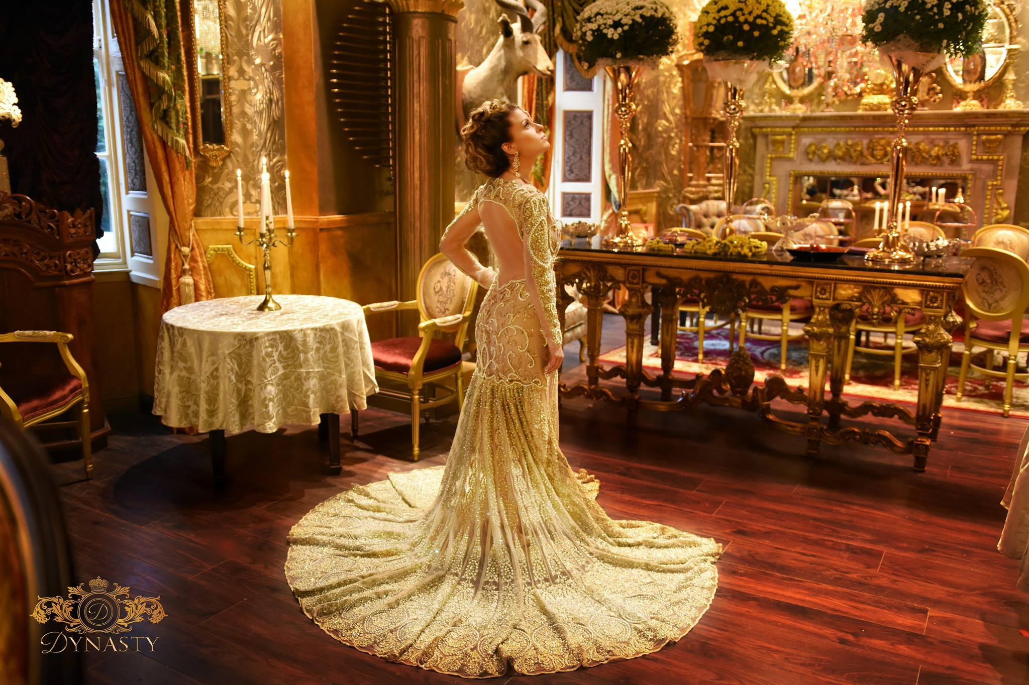 Dynasty's promotional photo shows a model admiring the opulent interior of the restaurant.