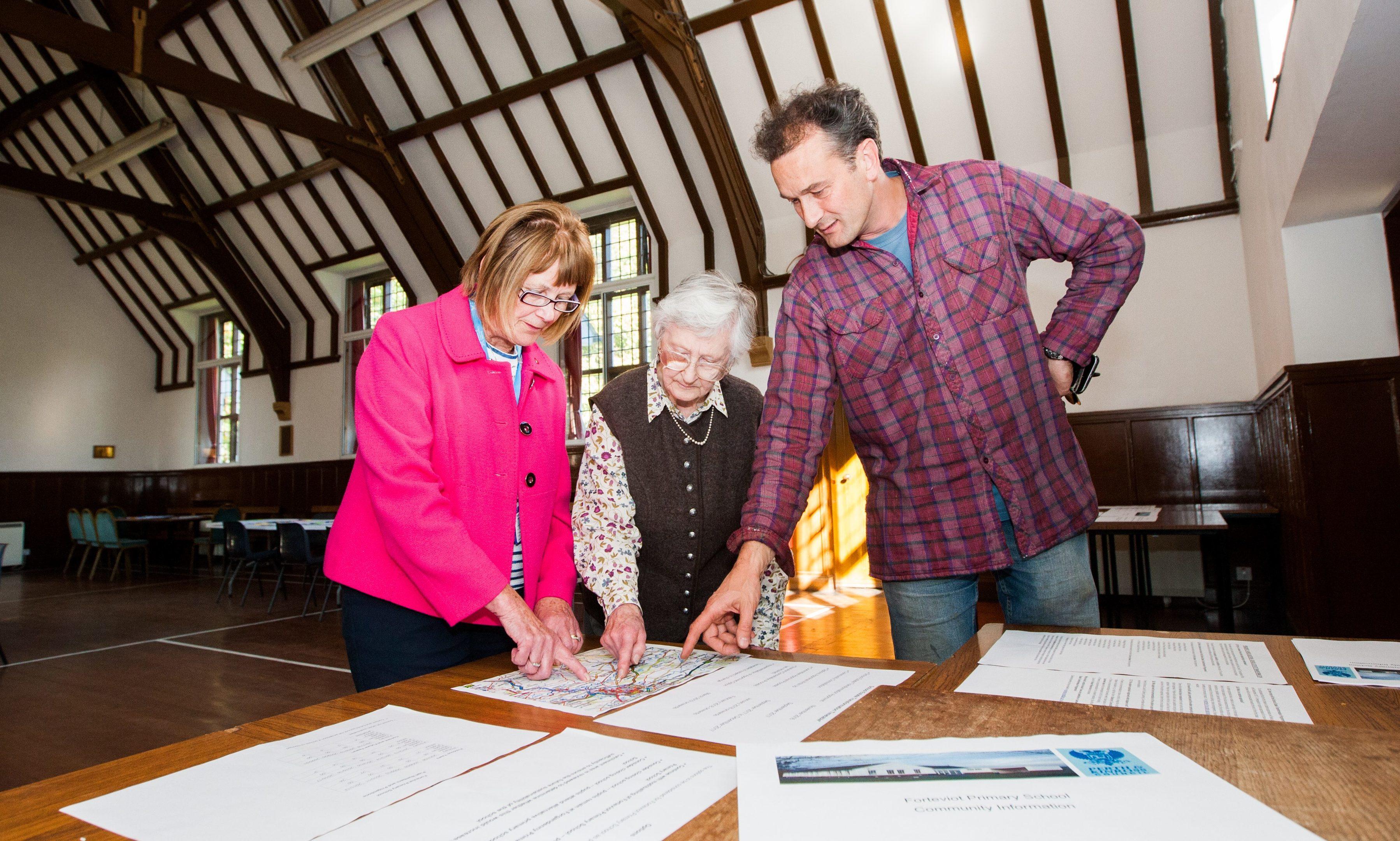 Councillor Kathleen Baird, Diana Roff (Earn Community Council) and Alexander Dewar (Dupplin Estate) consider proposals at the Village Hall, Forteviot.