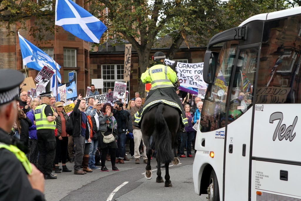 Mounted police on the scene as a bus full of SDL supporters arrives in Perth.