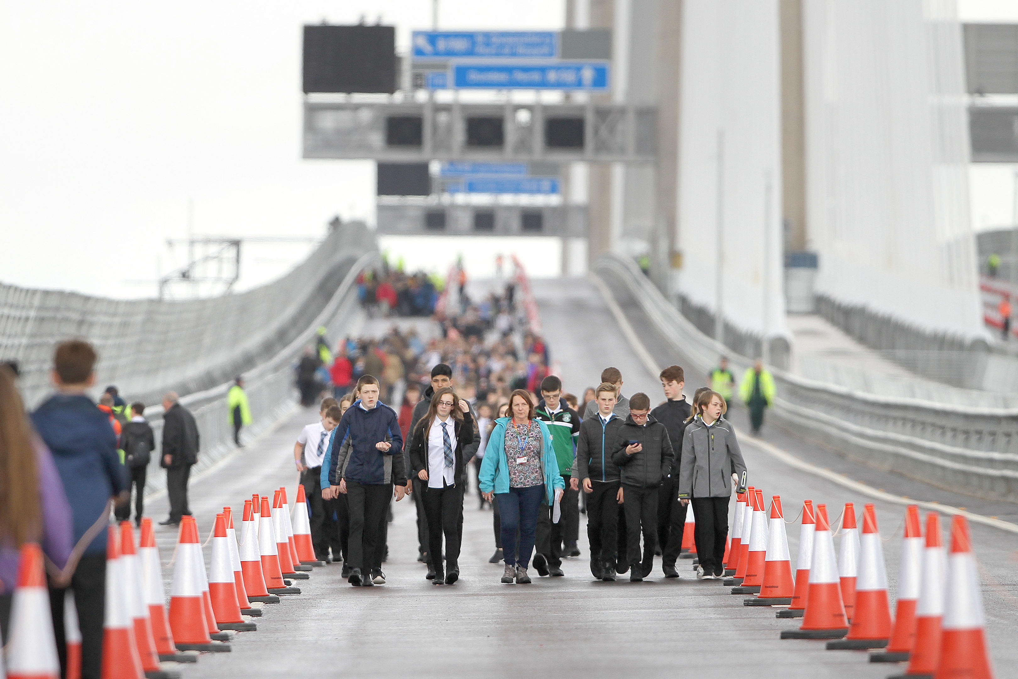 Pupils from Queensferry High crossing the bridge.
