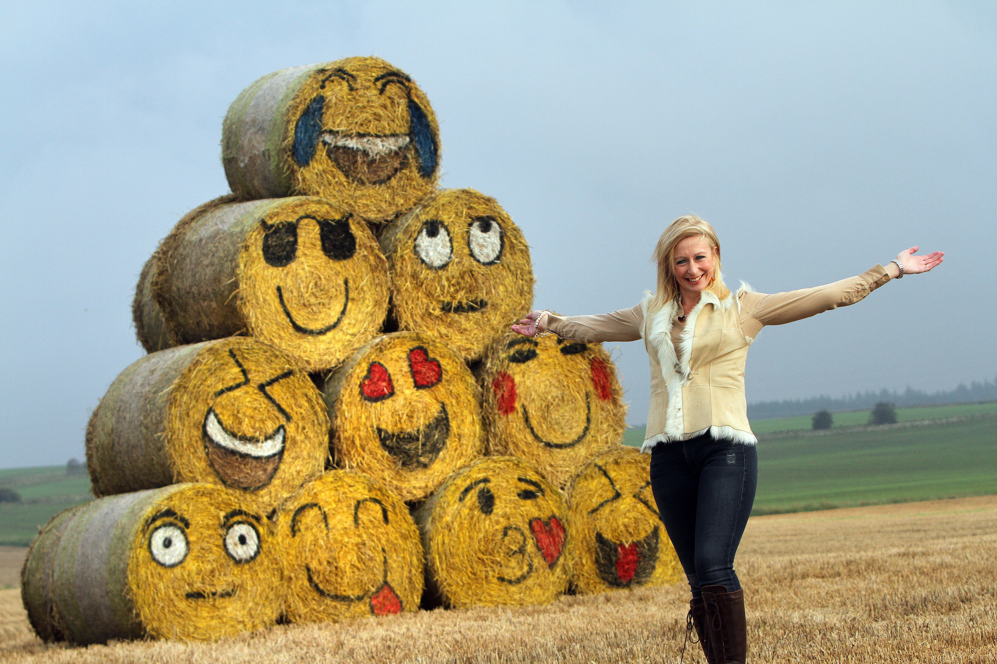 Fleur Baxter beside her emoji hay bales.