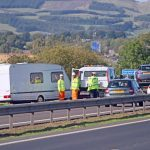 Delays after caravan goes on to its side on M90