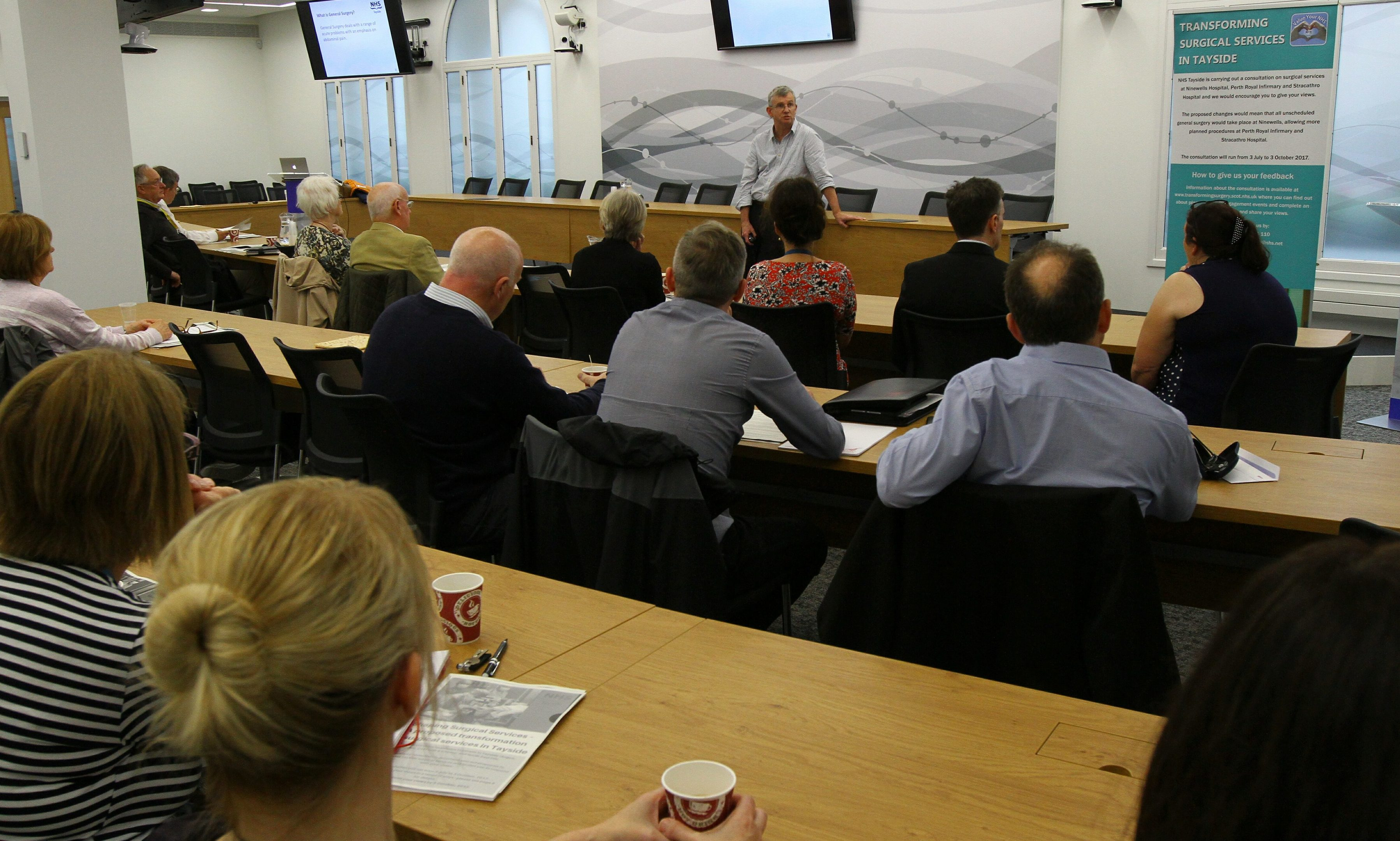 """Peter Stonebridge Associate Medical Director for Surgery, addressing the attendees at the public meeting """"Shaping Surgical Services"""" at Perth & Kinross Council HQ."""